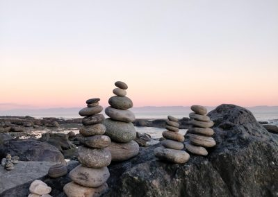 Stacked stones, also known as carins on Ocean Wilderness  Beach